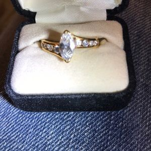 Lab created white topaz and gold ring. Size 8.